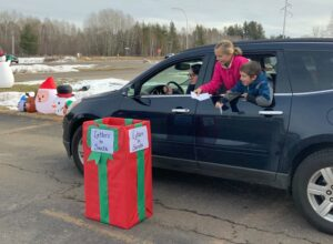 Kids dropping off letters to Santa.