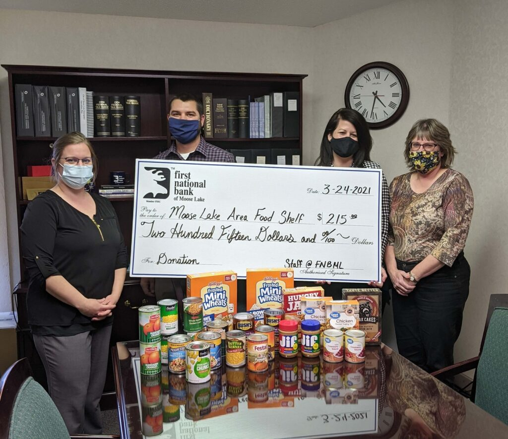 Kelly, Dan, Danielle, and Kristen are at the Main Bank with part of the donation to the Moose Lake Food Shelf